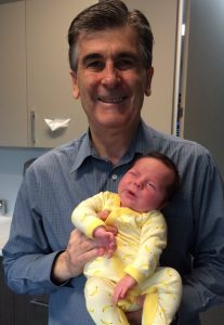 Dr Sykes holding a Baby